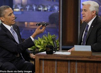 President Barack Obama giving Jay Leno a replica of his limo The Beast on The Tonight Show