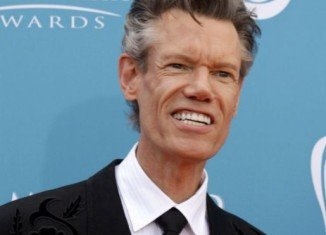 Randy Travis has left a Texas hospital, three weeks after he suffered a stroke
