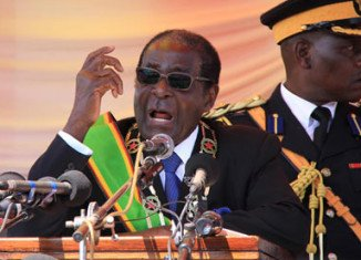 Robert Mugabe has launched a stinging attack on his opposition rivals in his first public speech since he won Zimbabwe's presidential election