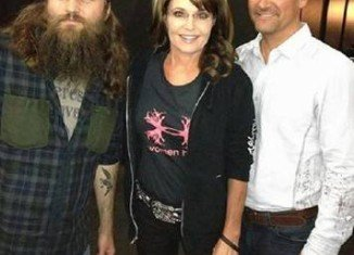 Sarah Palin and her husband Todd with Willie Robertson at the 2013 NRA convention