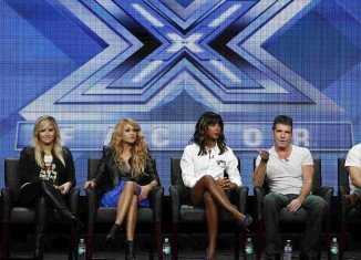 Simon Cowell tried to avoid questions about his impending fatherhood at an ill-timed X Factor press panel