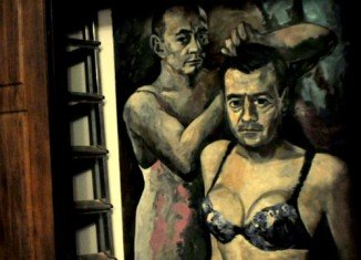 The portrait features President Vladimir Putin combing the hair of Russian PM Dmitry Medvedev
