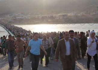 Thousands of Syrian refugees are pouring over the border into Iraqi Kurdistan