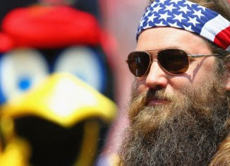 Willie Robertson told Mehgan Cook and Charlie Miller to always love and forgive one another as they were wed at a Field & Stream store near Pittsburgh