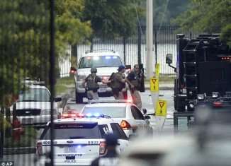 At least one heavily armed gunman opened fire inside a building at the Washington Navy Yard killing at least 11 people and injuring at least 12