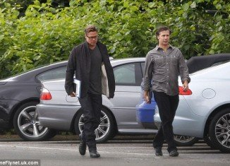 Brad Pitt has revealed a new short haircut as he arrived on the set of his new film Fury in London
