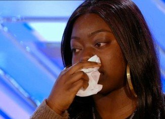 Hannah Barrett broke down in tears as she spoke to X Factor judges