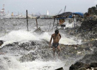 Villages have been evacuated, ferries suspended and flights cancelled in Philippines and Taiwan as Typhoon Usagi goes through the Luzon Strait which divides them