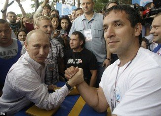 Vladimir Putin and a group of American politicians had an arm-wrestling match a few years after the fall of the Berlin wall