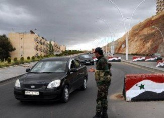 At least 16 Syrian soldiers have been killed in a suicide bombing and fighting that followed in Damascus suburb of Jaramana