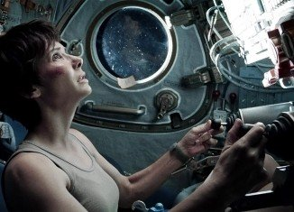 Gravity has topped the North American box office for a second consecutive weekend