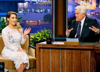 Kim Kardashian was proudly flaunting her famous curves during an appearance on The Tonight Show With Jay Leno