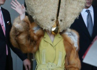 Lady Gaga wearing a furry cheese mask in Berlin