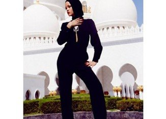 """Overseers of Abu Dhabi's Sheikh Zayed Grand Mosque asked Rihanna to leave the compound after she posed for photographs considered to be at odds with the """"sanctity"""" of the site"""