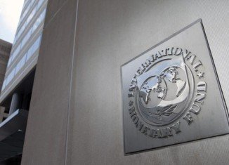 The IMF has cut its forecast for global economic growth at the same time as lifting its UK growth projection