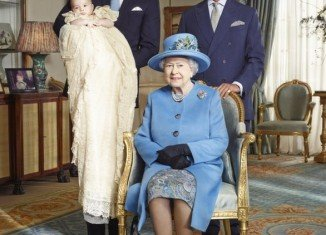 The Queen is shown with her son, the Prince of Wales, grandson, the Duke of Cambridge, and great-grandson, Prince George, to mark the royal christening