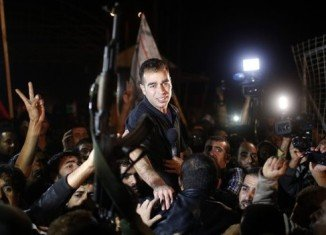 The second of four batches of 26 Palestinian prisoners have been released in Israel as part of a deal for the resumption of peace talks