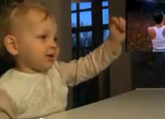 This toddler is coming up with his own Bohemian Rhapsody by mimicking the moves of Queen legend Freddie Mercury