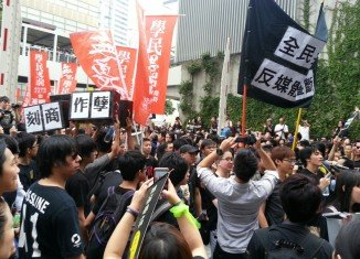 Thousands of people in Hong Kong have taken to the streets to protest against what they see as a lack of government transparency and accountability