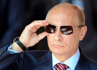 Vladimir Putin has topped Forbes magazine's World's Most Powerful People list in 2013