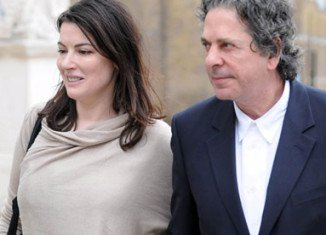 Charles Saatchi and Nigella Lawson broke up in the summer after pictures were published showing the millionaire art dealer holding his wife by the throat at the restaurant in Mayfair