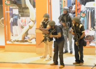 Four men have been charged over Nairobi's Westgate mall attack, in which more than 60 people were killed