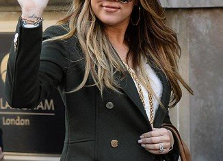 Khloe Kardashian says she doesn't regret letting cameras track her life but admits it's a double edged sword