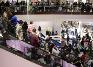 Outbreaks of violence have marred Black Friday shopping frenzy, as bargain-hunters besieged malls across the US