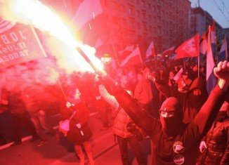 Police have fired rubber bullets and tear gas to break up violent clashes during Poland Independence Day march in capital Warsaw