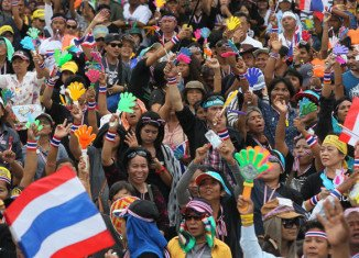 Thai protesters have surrounded several more ministries, as street demonstrations continue in Bangkok