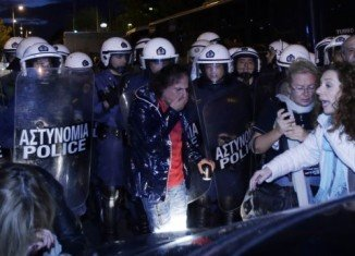 The headquarters of Greece's former state broadcaster ERT have been cleared by riot police