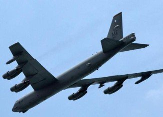 Two US B-52 bombers flew over disputed islands in the East China Sea in defiance of new China's air defense rules
