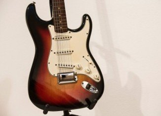 Bob Dylan's Fender Stratocaster electric guitar has been sold at New York auction for a record $965,000