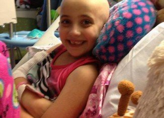 Delaney Brown received support from thousands of Christmas carolers outside her home over the weekend