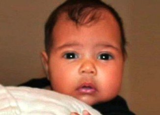 Kim Kardashian's 5-month-old daughter North West tried out swimming for the first time