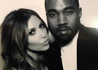"Kim Kardashian and Kanye West inside the ""Naughty or Nice"" photo booth"