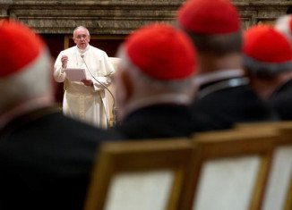 Pope Francis told Vatican officials he wants them to display professionalism and competence as well as holiness in their lives