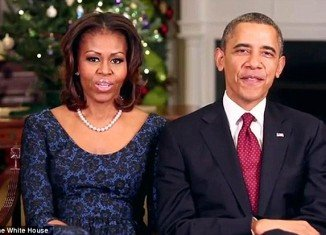 President Barack Obama urged Americans to remember troops serving far from home and embrace the spirit of the season and give back in his annual Christmas message