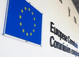 The European Commission has fined eight banks a total of 1.7 billion euros for forming illegal cartels to rig interest rates