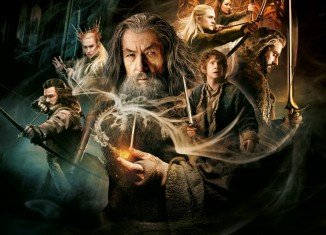 The Hobbit: The Desolation Of Smaug has topped the US box office for a third week despite festive competition from The Wolf Of Wall Street