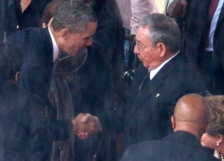 The White House said President Barack Obama and Cuba's President Raul Castro's handshake at Nelson Mandela's memorial service was unplanned