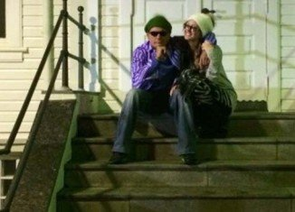 Charlie Sheen and Brett Rossi in front of the former French consulate building in Reykjavik