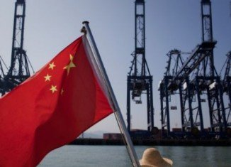 China's economy grew at its slowest pace in 14 years in 2013