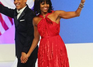 Michelle Obama's ruby-colored chiffon gown made by designer Jason Wu is being lent to the National Museum of American History for a year