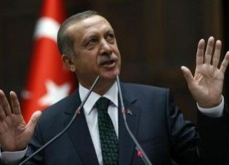 PM Recep Tayyip Erdogan says he favors the retrial of hundreds of military officers convicted of plotting to overthrow the government