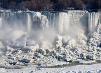 Plummeting temperatures in the US and Canada have caused chaos for many but have created a spectacular sight at Niagara Falls