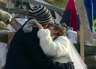 The newly-married couple has climbed to the top of a protest barricade in Kiev to celebrate their wedding