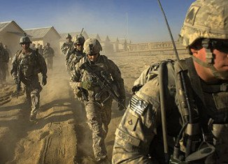 Barack Obama has warned Afghan President Hamid Karzai that the US may pull all of its troops out of his country by the year's end