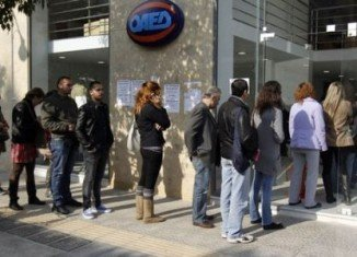 Greece's unemployment rate reached a record high of 28 percent in November 2013