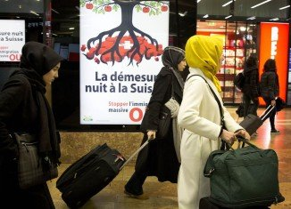 The Swiss vote to bring back strict immigration quotas for Europeans draws criticism from France, Germany and Brussels